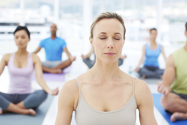 woman meditating yoga class